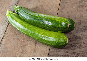 Zucchini squash on wooden table