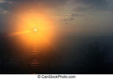 Sun rising over Bali island in Indonesia
