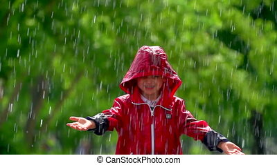 Heaven Sent Rain - Happy kid having fun in the rain