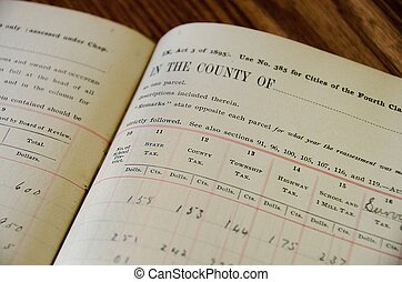 old tax ledger in book - Old property tax record in book.