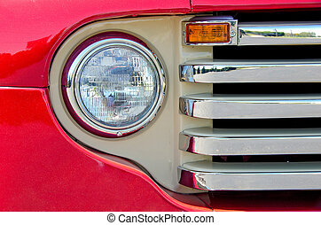 headlight of old red truck