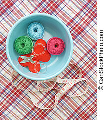 sewing kit, needles, thread and measuring tape