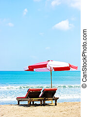 Umbrella and two chairs on beach