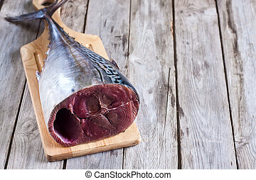 Raw tuna - Fresh raw tuna tail on wooden board Selective...