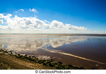 Clouds reflected in coastal water - Blue sky and cloudscape...