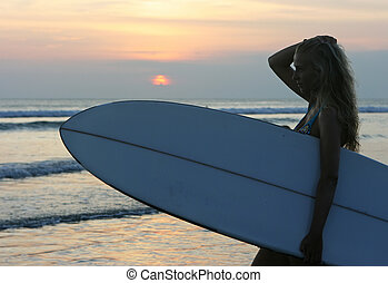 Surfing girl - Girl with surf standing on the beach on Bali...