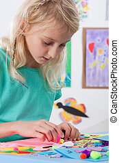 Girl at art lessons at school - Beautiful young girl at art...
