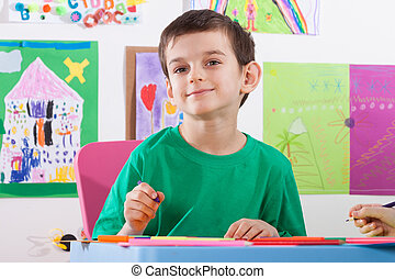 Boy on art lessons at school - Smiling boy on art lessons at...