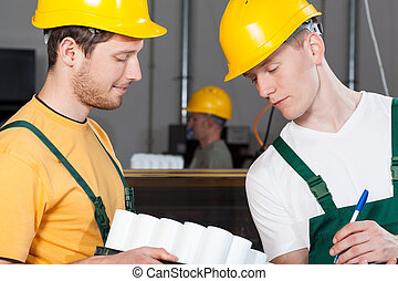 Control and inventory at warehouse - Workers during control...