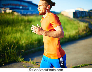 Jogger - Portrait of young attractive sportsman with...