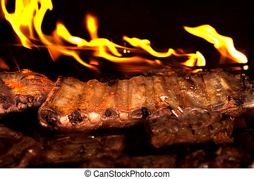 Juicy barbecue ribs - Grilled ribs on barbecue Family party...