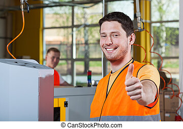 Machine operator showing thumbs up sign - Machine operator...