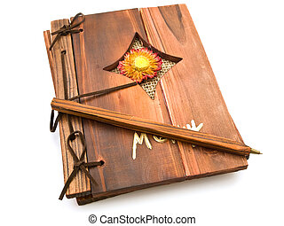 book and pen - ancient wooden book and pen against the white...