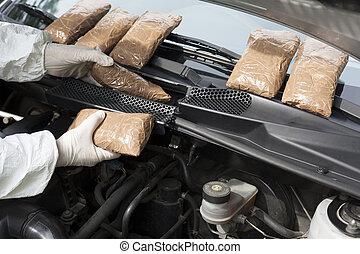drug smuggled in a car's engine com - hidden drugs in a...