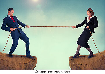 man and woman tug of war - businesman and woman tug of war