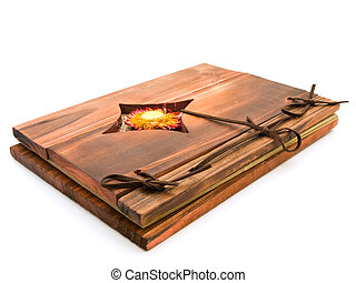 ancient wooden book against the white background