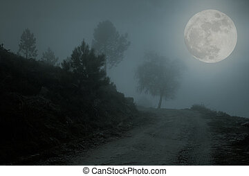 Abyss - Mountain road that borders a precipice in a misty...