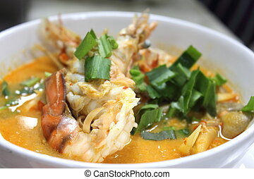 Sour and Spicy soup with Prawn Thais Tomyum kung in a bowl...