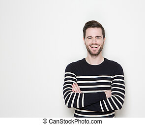 Portrait of a smiling man with arms crossed
