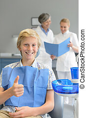Teenager visit dentist at dental surgery thumbup - Teenager...