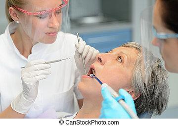 Dental team checkup elderly patient woman teeth - Dental...