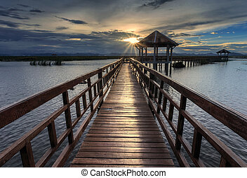 The long wooden bridge during sunset - The long bridge over...