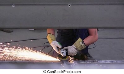 Industrial Grinding - Sparks flying off a metal workpiece...