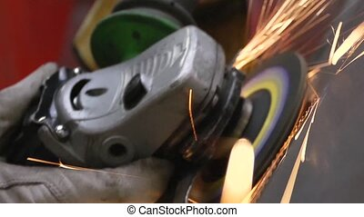 Grinder and deburring - Sparks flying off a metal workpiece...