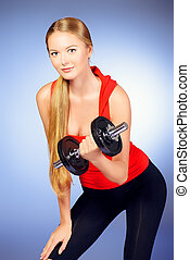 fitness training - Young slender woman goes in for sports....