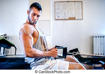 Muscular man on daily workout at gym. Fitness concept of a...