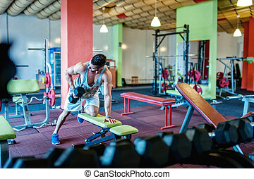bodybuilder working out and training at the gym