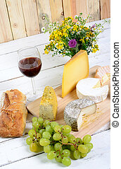 french cheese tray with seasonal fruits