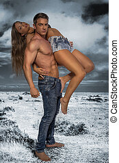 Hunky male carrying female model - Hunky male with no shirt...