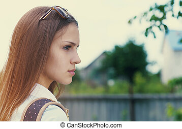 Portrait of a beautiful teen girl in sunset light
