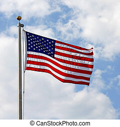 American Flag in front of Cloudy Blue Sky - A red, white and...