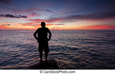 Silhouette of single man at sunset - Silhouette of a single...