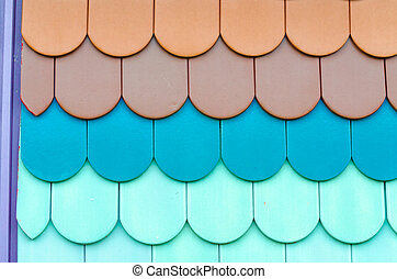 Close-up of colorful tiles - Close up of red, black roof...
