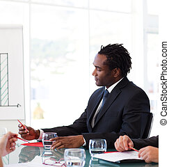 Afro-American businessman in a meeting