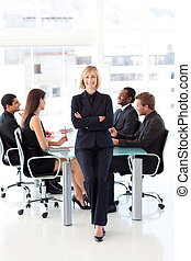 Friendly businesswoman smiling at the camera in a meeting -...