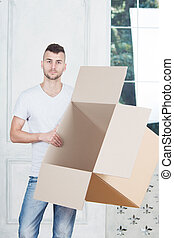 Removal is not easy thing - Handsome young smiling man...