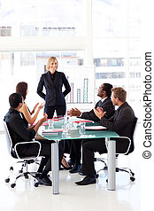 Business people clapping their manager in a meeting