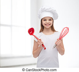 smiling girl in cook hat with ladle and whisk - cooking and...