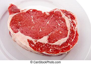 Ribeye Steak on White Plate - A fresh, juicy, ribeye steak...