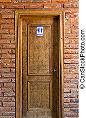 Wooden door frame and brick - Entry to bathroom and wooden...