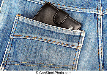 Black leather wallet sticking in the back pocket of denim  blue