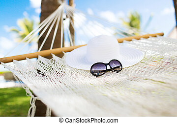 picture of hammock with white hat and sunglasses - vacation...