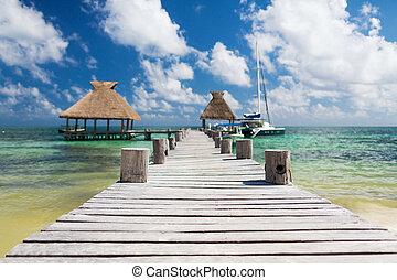 wooden pier with blue water around