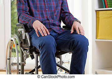 Capable man in shirt on wheelchair - Capable man in shirt is...