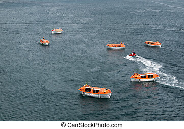 Lifeboats - Orange and white lifeboats training and testing...