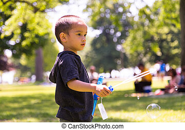Young Child Playing with Bubbles